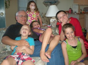 Grandchildren climbing all over Grandpa Ken