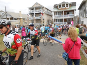 Bikers walk their bikes to the staging area after completing the race.