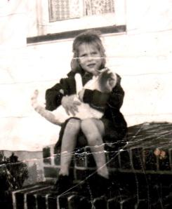Five-year-old Janice and the family cat, Thomasoulo.