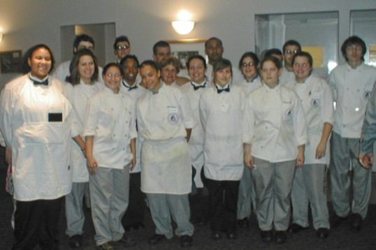 The students at the culinary school gather in the student-run restaurant, Careme's,, for cheers from the dining room guests.