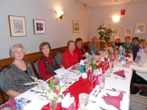 ladies love to wear red at Christmas time. And notice the lovely red table decorations.