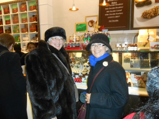 AS happy as two chocoholics in Godiva's Chocolates Store in New York City