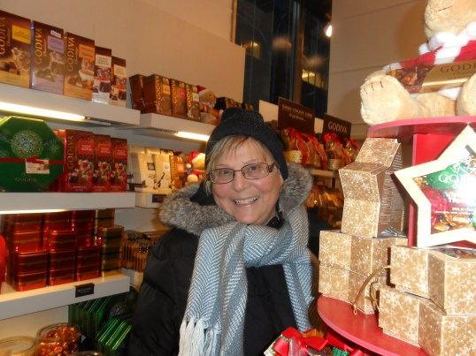 As happy as a chocoholic hiding behind the chocolate display in Godiva's Chocolates...not telling how much I bought!