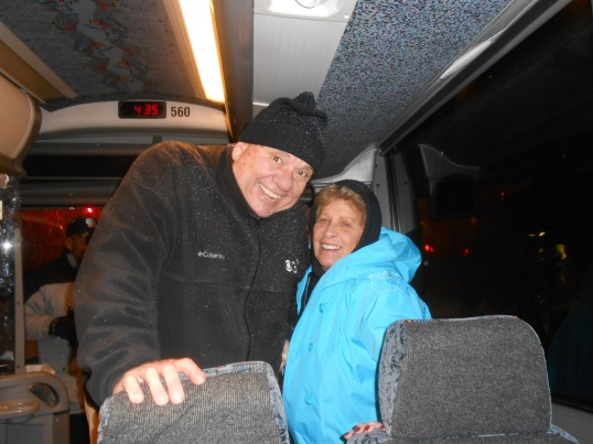 As happy as two shoppers getting back on the bus for home after spending a wet, snowy (but fun) day in New York City.