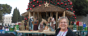 Janice at the manger scene and Christmas tree in Bethlehem square, December, 2012