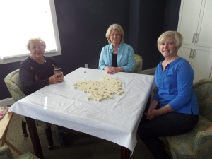 Suzanne, Linda, Cathy, and I stir up the tiles to begin our game of mahjong.