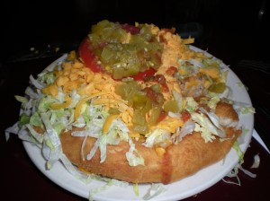 Indian fry bread taco. For a recipe go to Navajo Fry Bread: http://whatscookingamerica.net/History/NavajoFryBread.htm