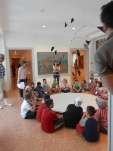 A school group visits the museum