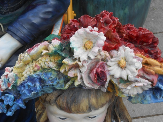 Perhaps they talk about the lovely flowers in the daughter's hat.